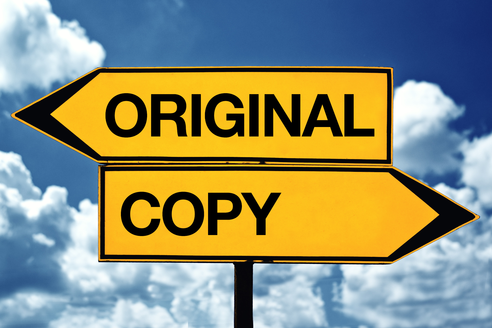 "two street signs, one pointing left with the word ""original."" The other pointing right with the word ""copy."""